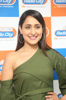 Pragya Jaiswal in a single Sleeves Off Shoulder Green Top Black Leggings promoting JJN Movie at Radio City 10.08.2017 128.JPG