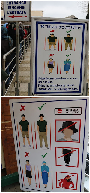 Strict dress code to cover your hair and neck with scarf and clothing to cover your shoulder and legs before entering Blue Mosque at Sultanahmet Square in Istanbul, Turkey