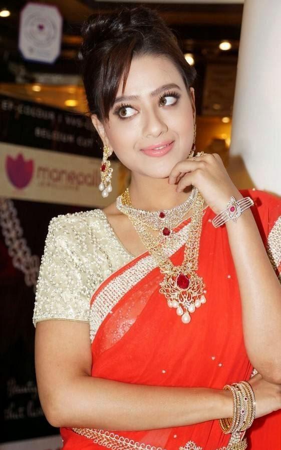 Madalsa Sharma Hot Looking Photos In Orange Saree