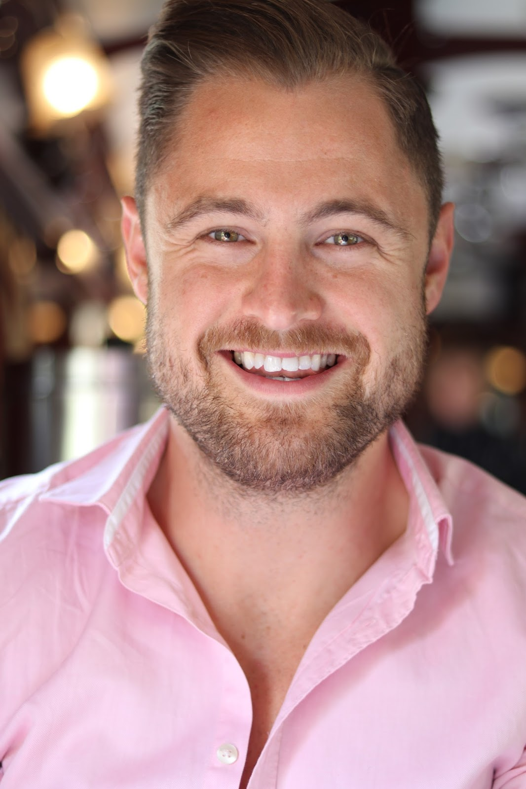 Ben Heath wearing a pink shirt aboard Rovos Rail