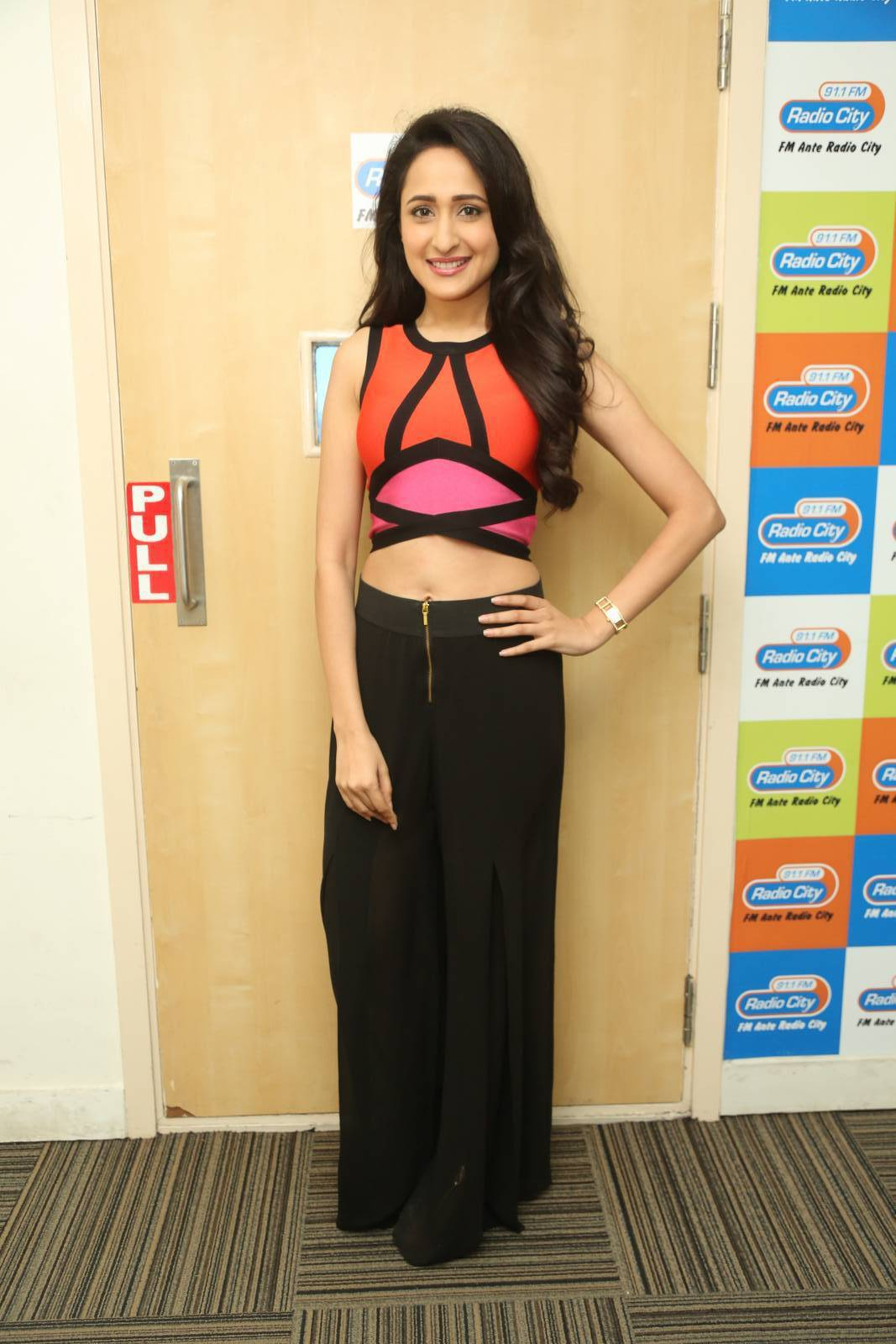 Tollywood Actress Pragya Jaiswal Hot Long Hair Style Photos In Orange Top