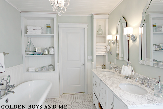 Master Bath with white subway tile, pedestal tub, carrera marble, chandelier, white octagonal hex tile, shower niche via www.goldenboysandme.com