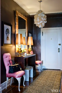 stylish and feminine entryway with pink chairs