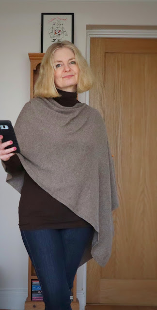 image showing poncho and poloneck sweater