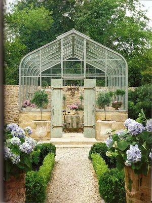 Elegant and luxurious French Country greenhouse with green shutter doors. Inspiring European Country Home Ideas {French Country Decor Inspiration}