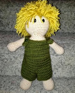 http://www.craftsy.com/pattern/crocheting/toy/crochet-doll-with-changeable-clothing/80373