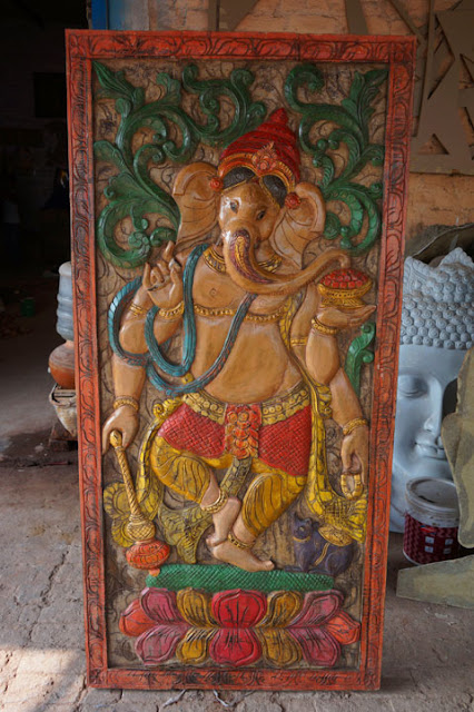 https://www.mogulinterior.com/ganesha-carved-wall-panel-god-of-prosperity.html