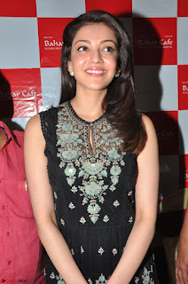 Kajal Aggarwal in lovely Black Sleeveless Anarlaki Dress in Hyderabad at Launch of Bahar Cafe at Madinaguda 020.JPG