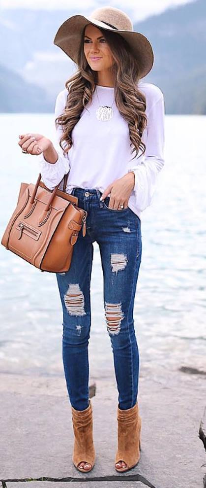 how to style a hat : ripped jeans + boots + bag + white top
