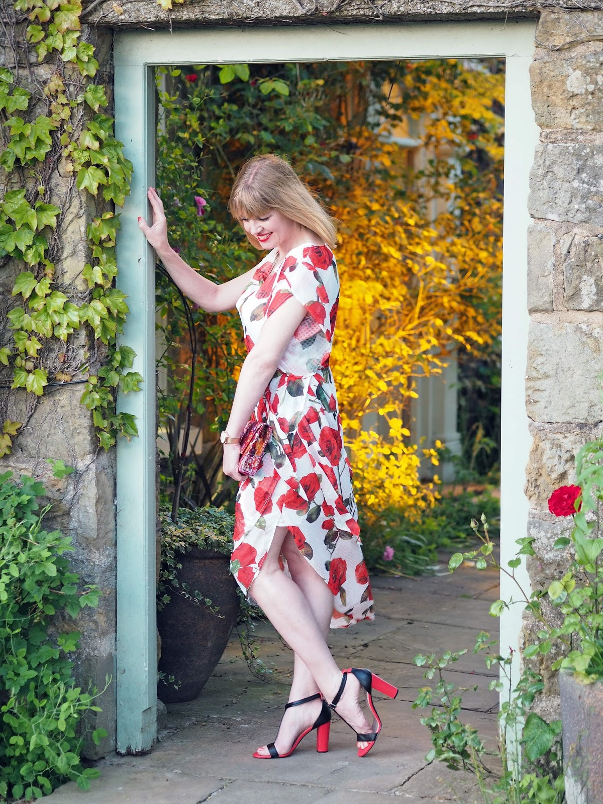 Alice's Pig White and red floral rose draped midi dress with red and black high-heeled Madeleine sandals