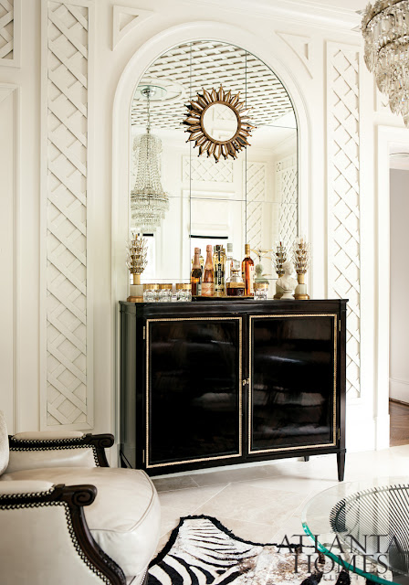 latice wall with black dresser