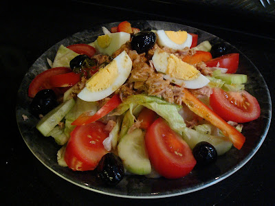 Salad: Assorted Greens, Tuna, Tomato Wedges, Pepper Strips, Black Olives, Cucumber Slices