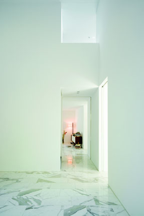 White interior room of The L House by Philippe Stuebi Architekten GMBH