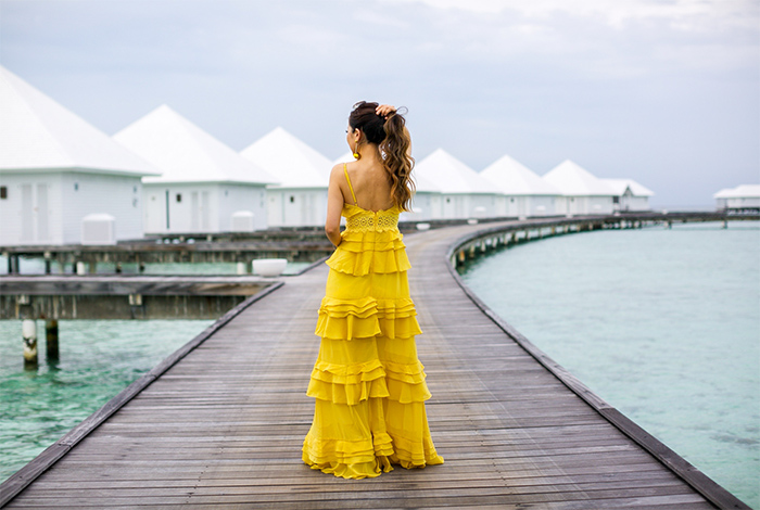 yellow tiered ruffle dress, ruffle dress, jeffrey campbell wedge sandals, baublebar earrings, maldives outfit, maldives travel, chloe sunglasses