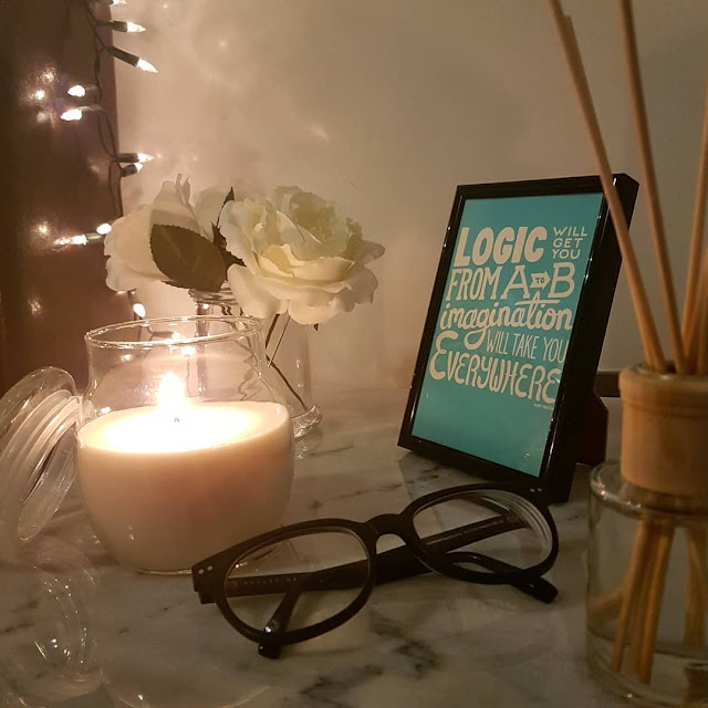 framed quote on bedside table