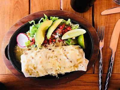 Pueblo Green Chili Smothered Pork Shoulder & Avocado Burrito at Restaurant 1858 at Seven Falls Colorado