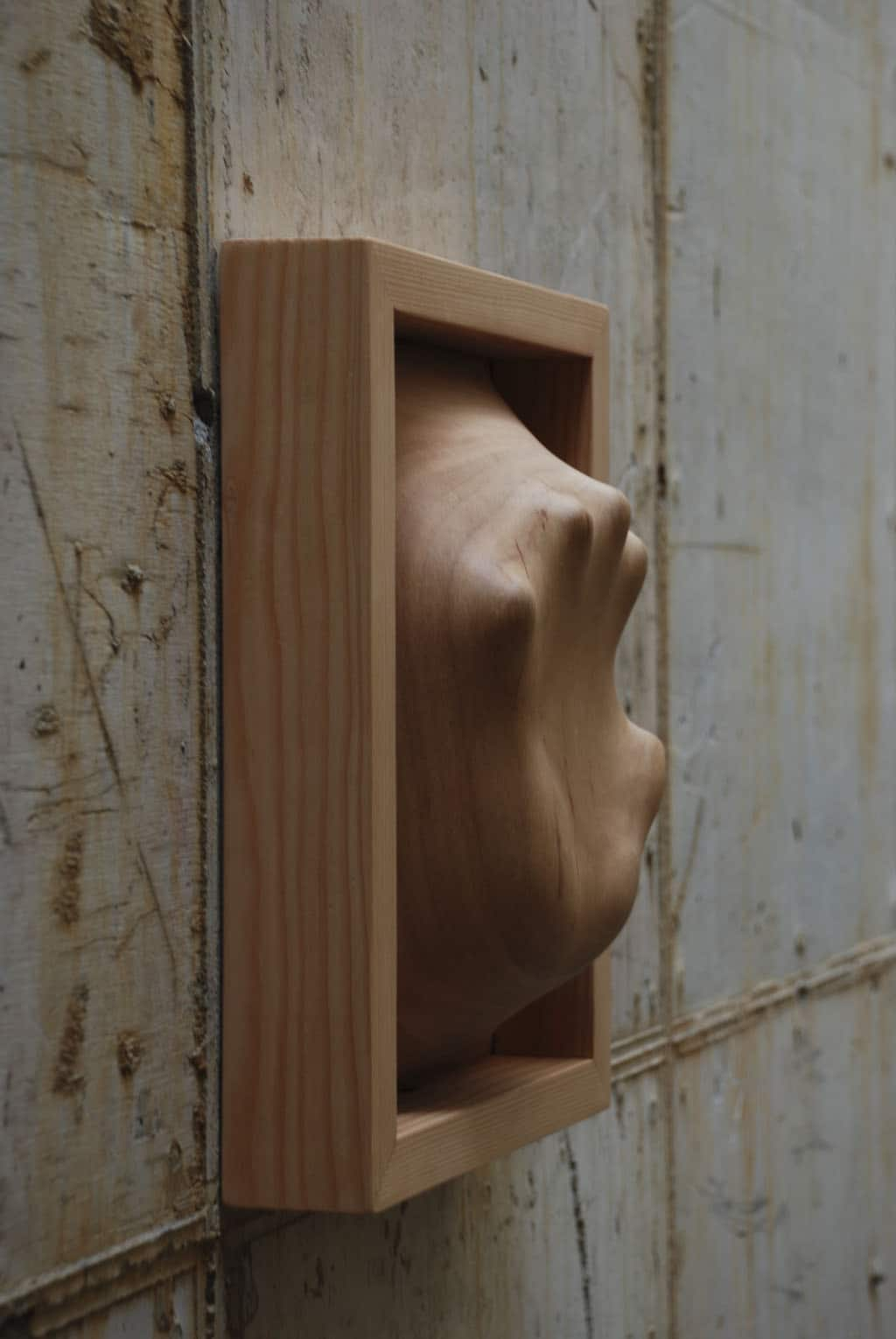 Beautiful Wood Sculptures Look Like Figures Are Trapped Inside Them