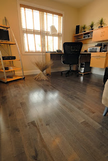 This gray hardwood floor lets the grain patterns shine beautifully