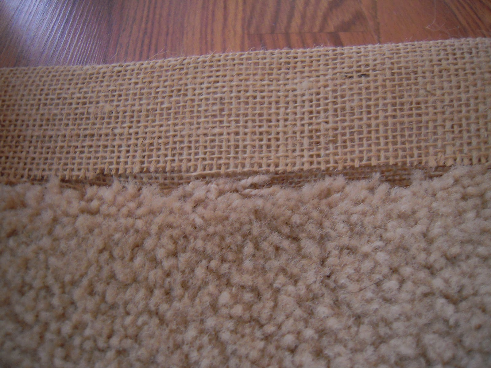 Apply Hot Glue To The Edge Of Carpet And Press Binding Into It