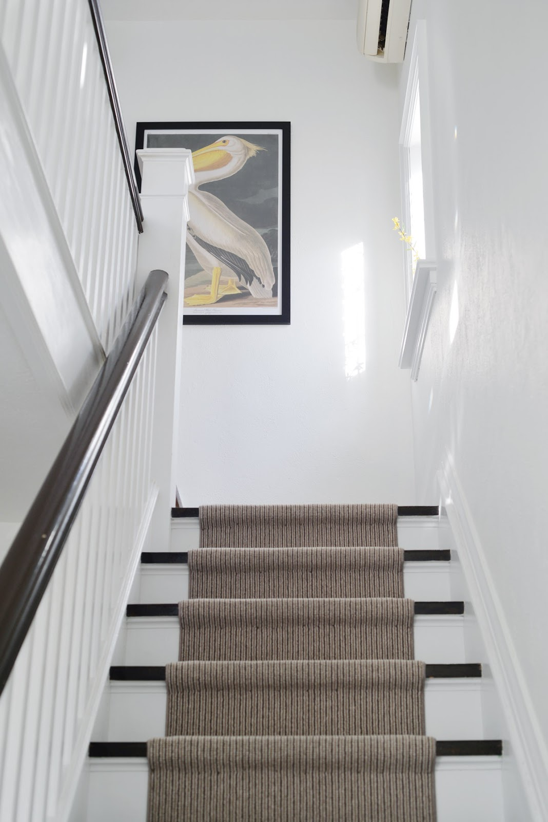 large scale art at top of stairwell | RamblingRenovators.ca