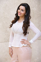 Kyra Dutt in Tight White Top Trousers at Paisa Vasool audio success meet ~  Exclusive Celebrities Galleries 015.JPG