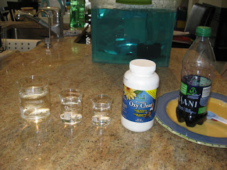 3 beakers filled with water and a bottle of PP solution