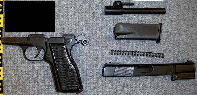 Disassembled pistol.
