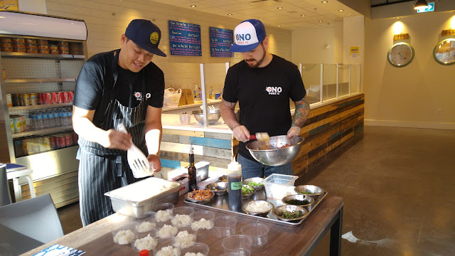 Chef Hui and Sous Chef Matt prepping the poke bowls during the 'ono poke sneak peek