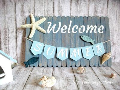 Insegna Coastal con stecchi gelato, bandierine, conchiglie e scritta Welcome Summer, casetta legno - MLI