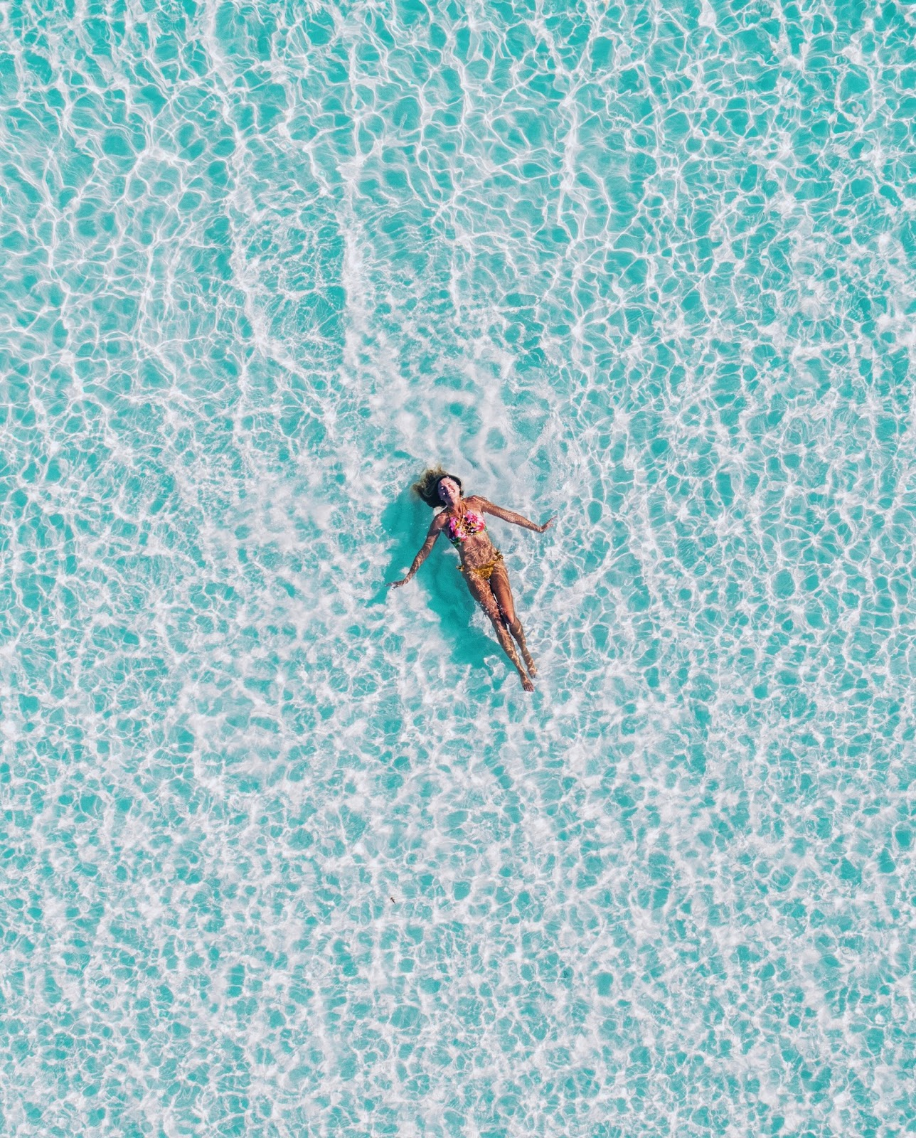Girl floating in Maldives
