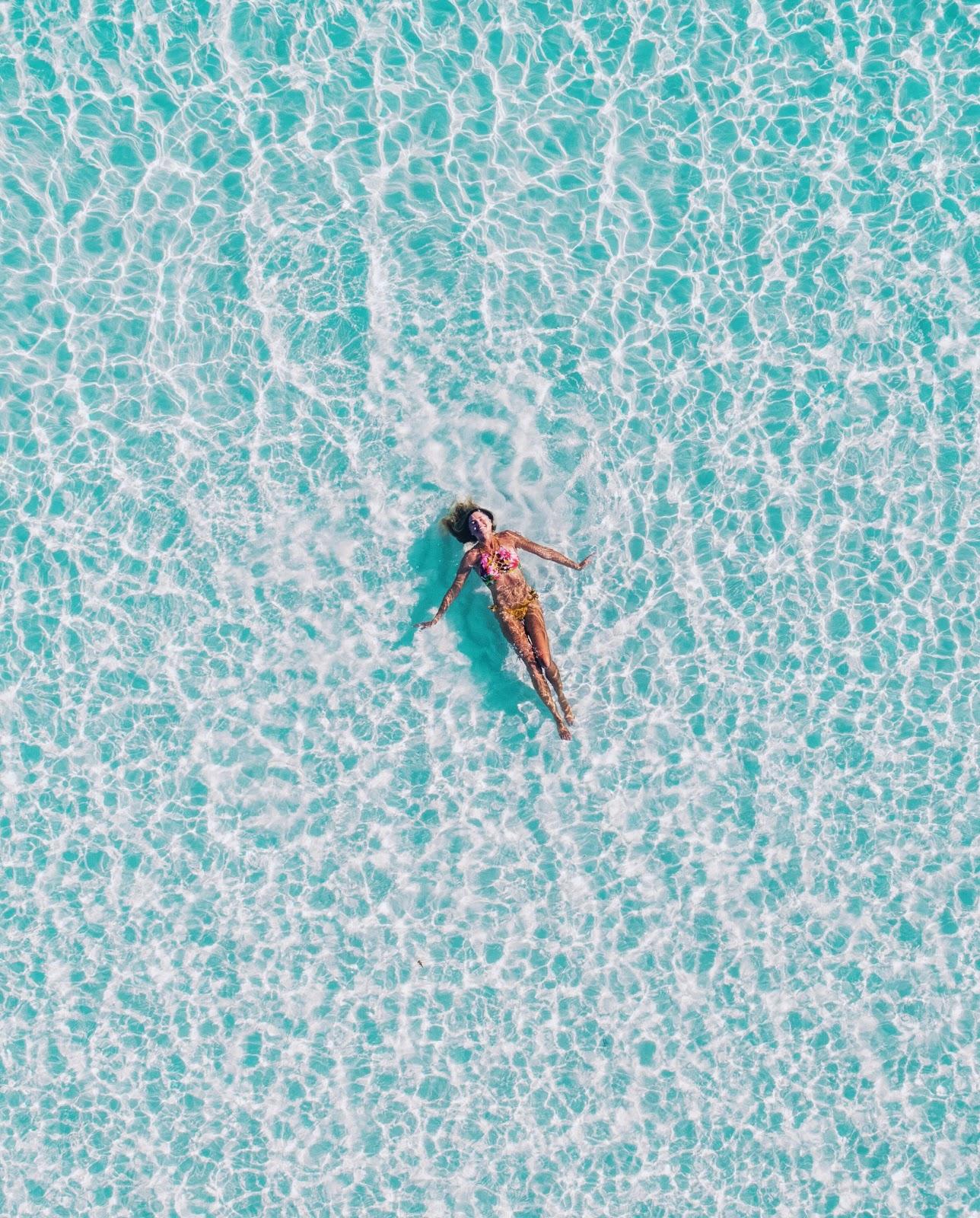 Girl floating in Maldives