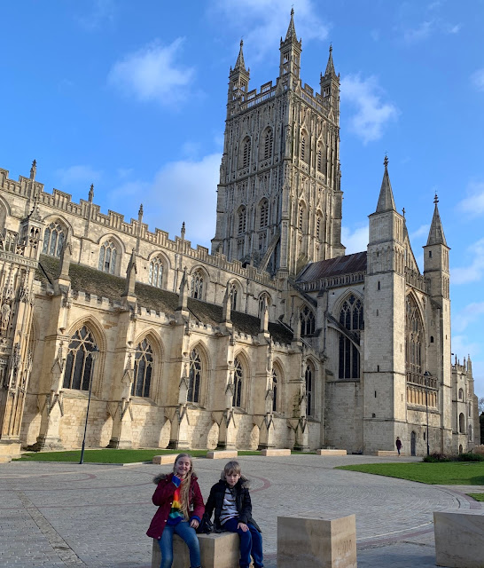 Child holding Gloucester Cathedral Discovery Trail