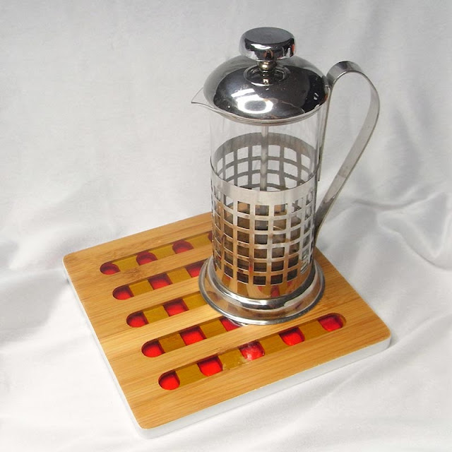 Resin and bamboo trivet with coffee plunger