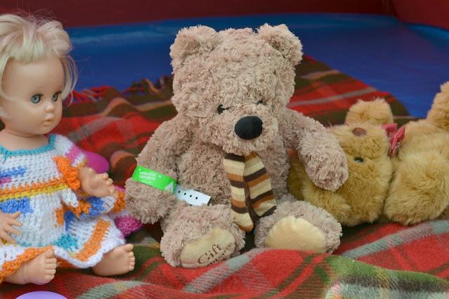 A teddy with a festival wrist band