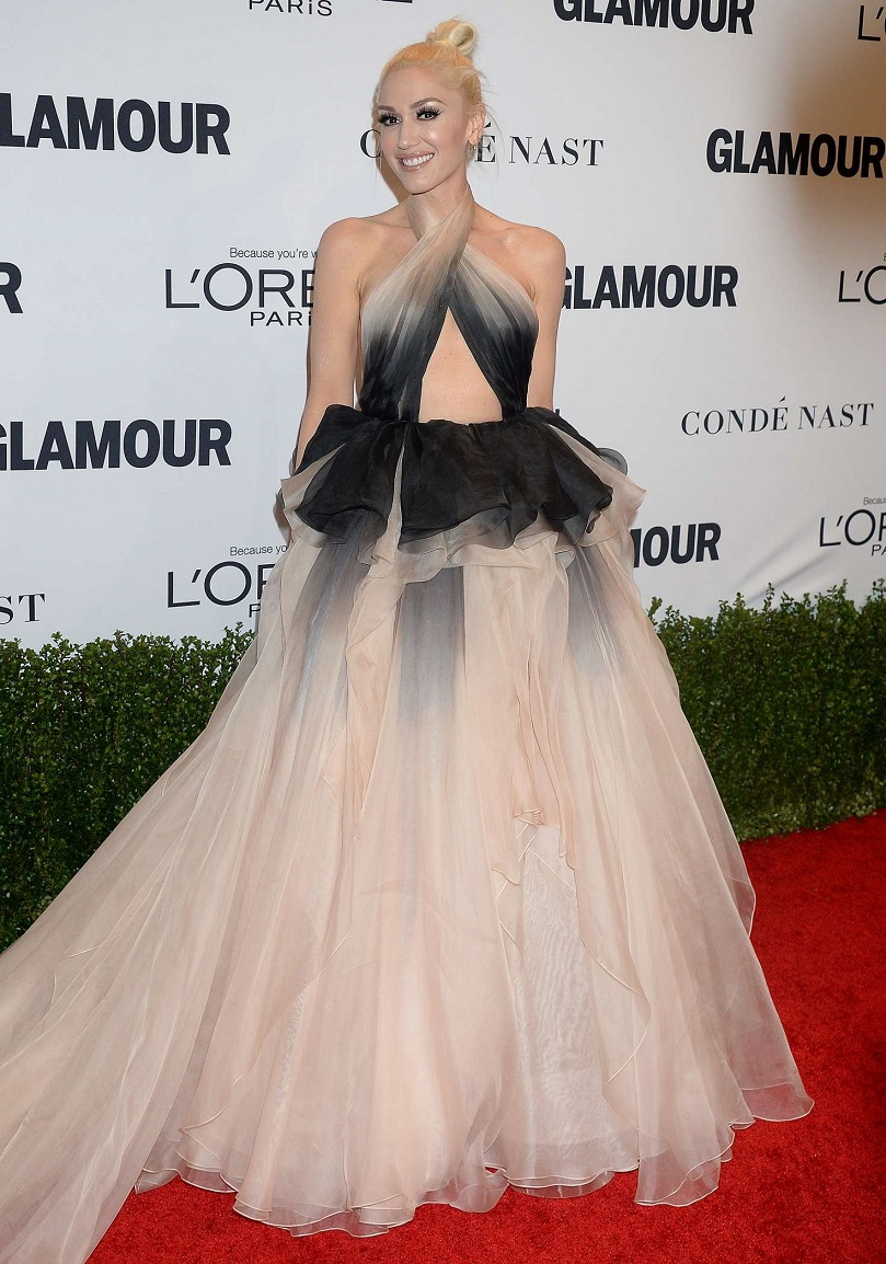Gwen Stefani glides down the Glamour Women Of The Year Awards red carpet in a stomach-baring ball gown