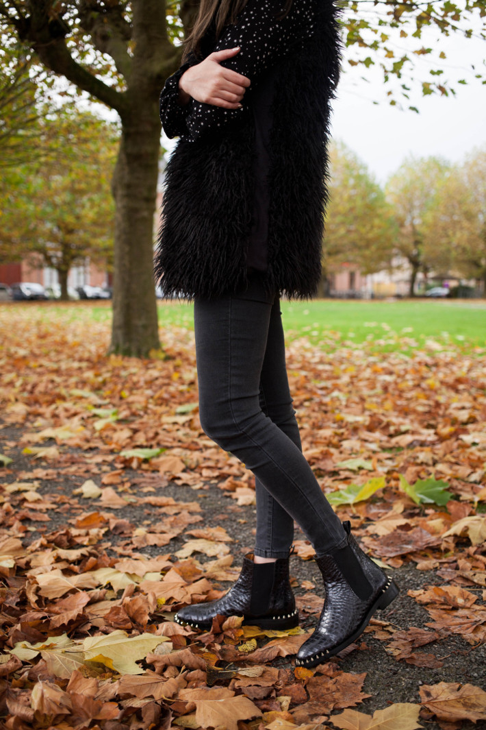 Outfit: all black outfit with spiky croc boots and shaggy faux fur vest