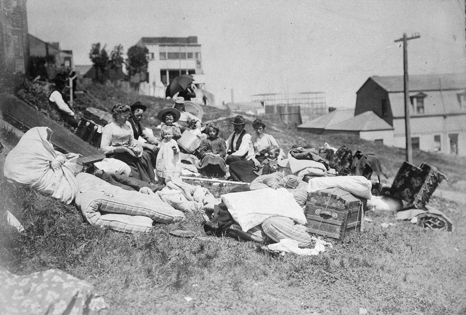 Refugees from the disaster rest on a hillside.