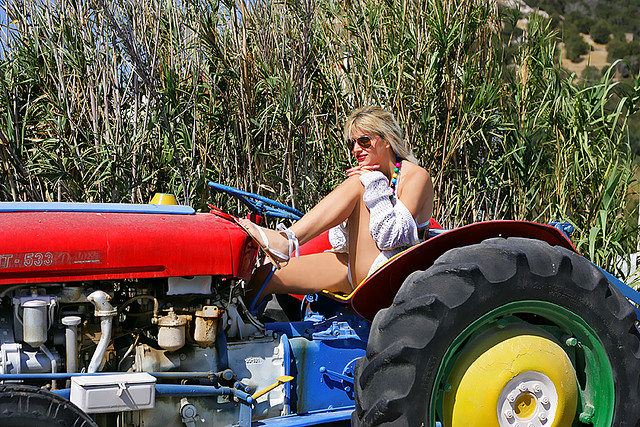 Naked girl on farm tractor