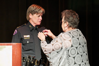 Alumna Susan Clifton receives her Assistant Chief stripes from her mother.