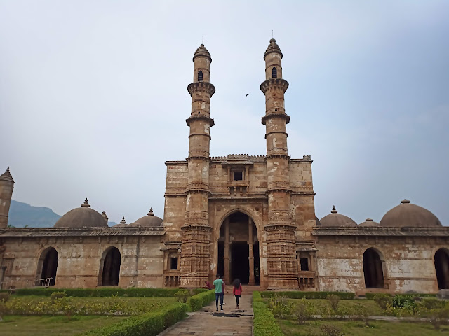 Facade of domed Jama Masjid building with two minarets in Champaner