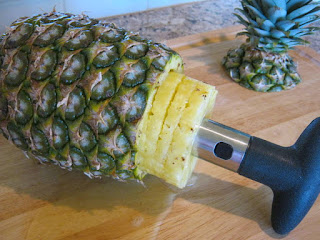 Use the handle to firmly pull the pineapple slices out of the pineapple.