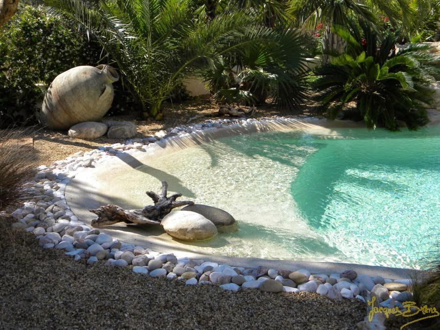 Autour de la piscine nc for Tour de piscine en galet