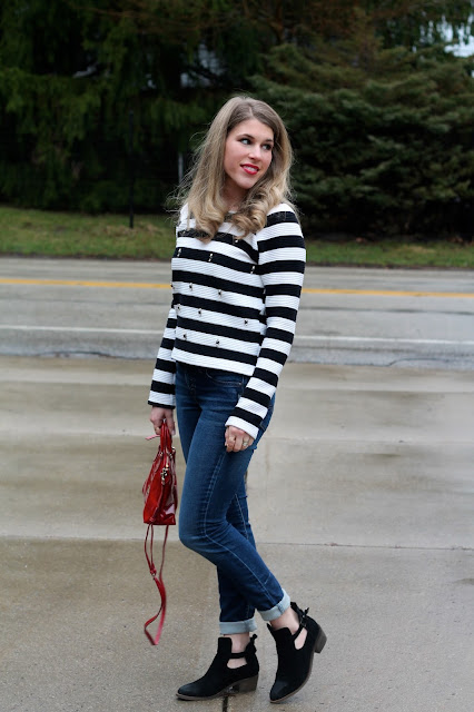 embellished striped sweater, Silver joga jeans, red Dooney & Burke bag, black cut out booties