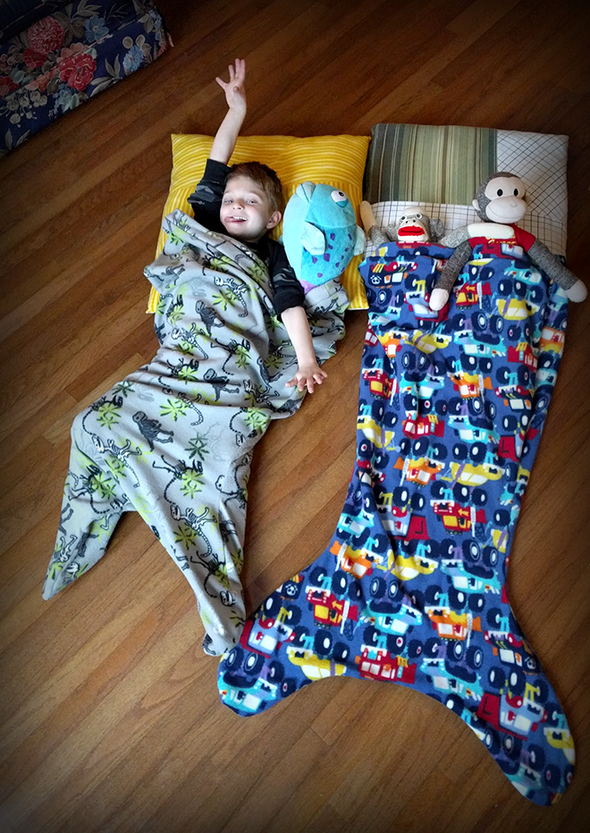 This mermaid blanket for kids is snuggly warm and fun.