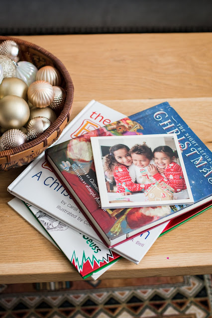 Christmas books and ornaments in a bowl as easy and inexpensive Christmas Decor