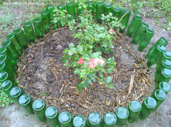 Rings Around the Rosies: 3 Repurposed Garden Borders mythriftstoreaddiction.blogspot.com Green glass bottles create a reflective garden border