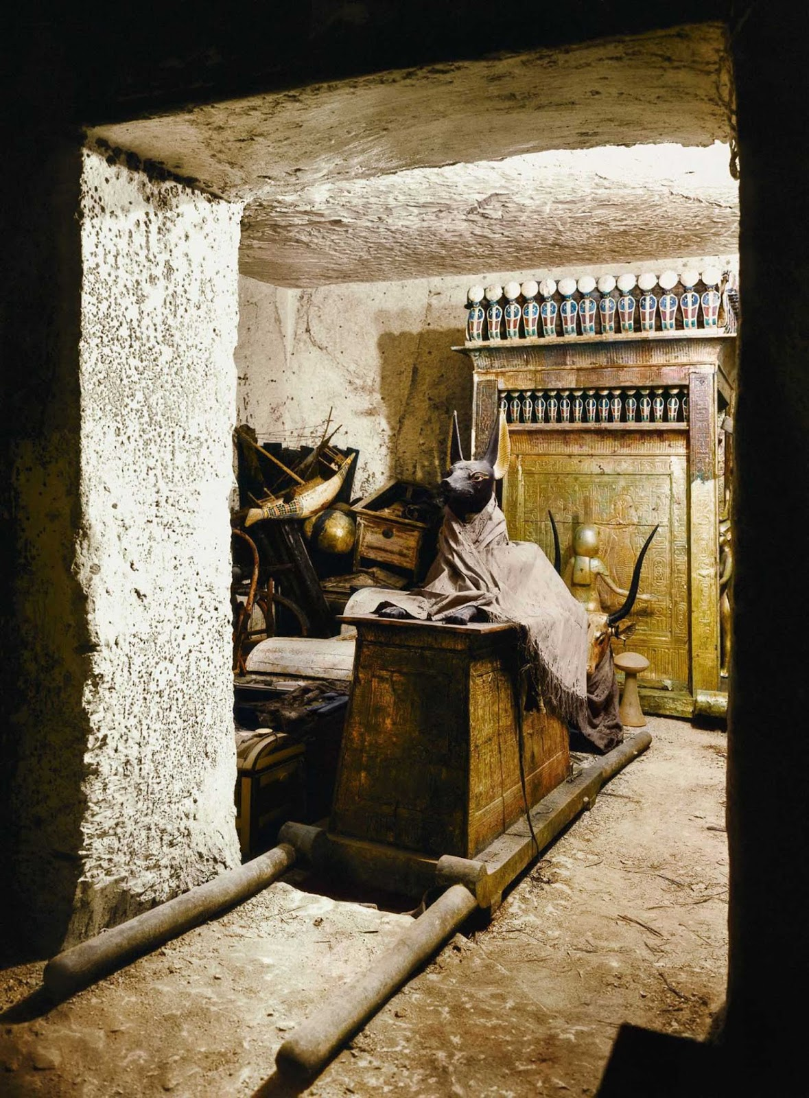 A statue of Anubis on a shrine with pallbearers' poles in the treasury of the tomb.