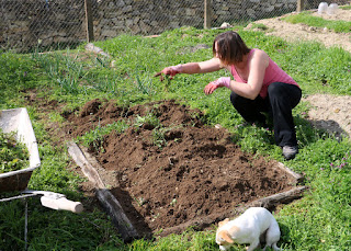 A getting her hands dirty in the garden