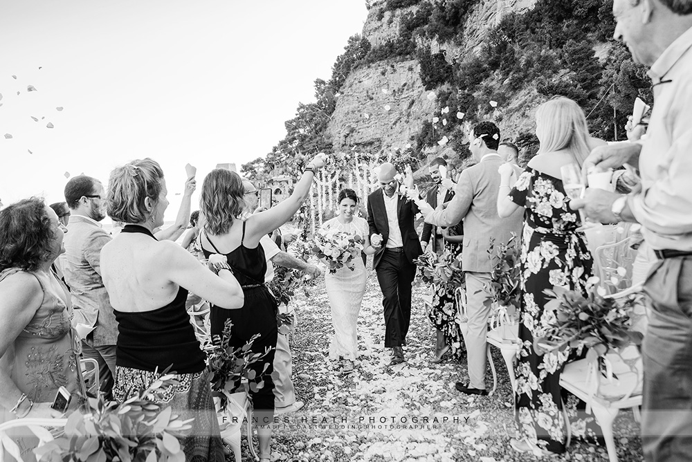 Bride and groom confetti recessional