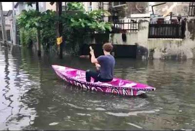 Foreigner using canoe in Lagos flood